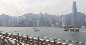Tsim Sha Tsui waterfront. Hong Kong, China - December 6, 2016: urban skyline Hong Kong skyline Tsim Sha Tsui Promenade and Avenue of Stars in Victoria Harbour stock video footage