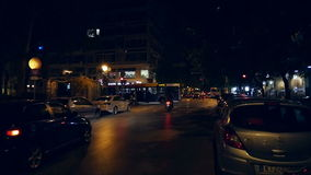 Tsimiski Street at night in slow motion. THESALLONIKI, GREECE - CIRCA 2015:  Tsimiski Street at night in slow motion. It is a major avenue in Thessaloniki, the stock footage