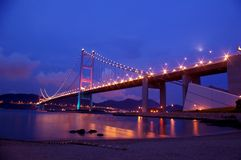 Tsing Ma Bridge in Hong Kong at night. It is one of the most famous bridge in the world Stock Image