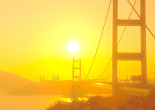 Tsing Ma Bridge in Hong Kong with the sunshine in soft focus Stock Images