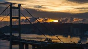 Tsing Ma bridge time lapse sun set. Timelapse shot telephoto zoom of Tsing Ma bridge in Hong Kong sunset stock footage