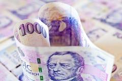 Tsjechisch papiergeld in een vorm van het hart - economie en financiën royalty-vrije stock afbeelding