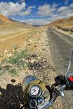 Expedition to the cultic Royal Enfield motorbike along roadless tracts Karakoram mountains. TSO MORIRI, JAMMU AND KASHMIR, INDIA - 07 JULY 2017: Motorbike Royal Royalty Free Stock Photos
