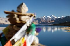 Tso Moriri Lake with prayer flags Royalty Free Stock Image