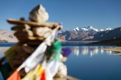 Tso Moriri Lake with prayer flags Royalty Free Stock Image