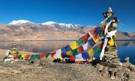 Tso Moriri Lake with prayer flags - Ladakh Stock Photo