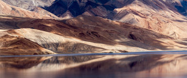 Tso Moriri mountain lake panorama with mountains reflections Stock Images