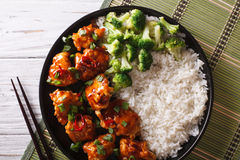 Tso's chicken with rice, onions and broccoli closeup. horizontal Stock Images