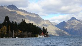 TSS Earnslaw Steamship moving by on the Lake Wakatipu in New Zealand. stock video