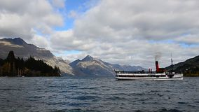 TSS Earnslaw Steamship moving by on the Lake Wakatipu in New Zealand. stock video footage