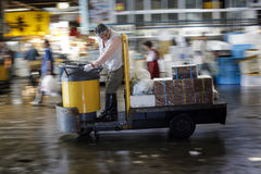 Tsukiji Fish Market Worker on Cart Royalty Free Stock Photography