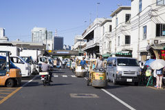 TSUKIJI, JAPAN - JULY 22 Merchants sale seafood in Tsukiji fish Stock Image