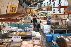 Tsukiji Market. TOKYO, JAPAN - MAY 11, 2012: Merchants sell seafood at Tsukiji Fish Market in Tokyo. It is the biggest wholesale fish and seafood market in the stock images