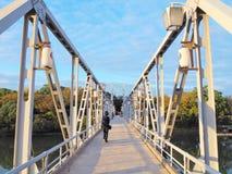 Tsukimi-bashi bridge in Okayama, Japan. OKAYAMA, JAPAN - NOVEMBER 20, 2015: Unidentified people walk on Tsukimi bridge. Tsukimi-bashi bridge is steel footbridge Royalty Free Stock Photo