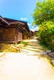 Tsumago-Dorf Nakasendo-Schotterweg-rustikales Haus Stockbild