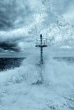 Tsunami. Wave impact the dock stock photos