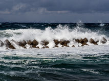 Tsunami barrier in Japan. With crashing waves Royalty Free Stock Images