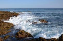 Tsunami danger in tropics. Big wave on Lanzarote's volcanic coast Royalty Free Stock Images