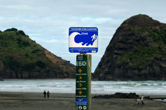 Tsunami evacuation route sign. PIHA, NZ - MAY 30:Tsunami evacuation route sign on May 30 2013.A seabed earthquake along numerous stretches of the NZ coast can Stock Image