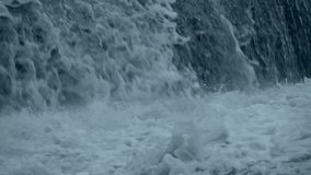 Tsunami is a giant white wave. Slow motion close to stock footage