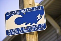 Tsunami Hazard Zone. In case of earthquake, go to high ground or inland Royalty Free Stock Photos