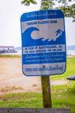 Tsunami hazard zone sign. Tsunami zone warning sign, Thailand danger symbol tropical traffic road control street travel electricity help white caution background stock photography