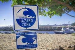 `Tsunami Hazard Zone` warning sign. Standard `Tsunami Hazard Zone` warning sign on the Pacific Ocean coast, Santa Cruz, California stock photography