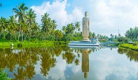 Tsunami Memorial in Sri Lanka. Tsunami Honganji Viharaya is the giant Buddha Statue, dedicated to Tsunami victims, located on the tiny island and surrounded by Stock Photo