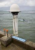 Tsunami monitor. A tsunami monitor hangs off the Hanalei Pier in Hanalei Bay, Kauai royalty free stock photography
