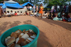 Tsunami Survivors. December 31, 2004 - An aid agency in Pondicherry, India, distributes bread to tsunami survivors in a small school compound  four days after Stock Image