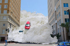 Tsunami tidal wave flash flood. Tsunami tidal wave washing through a city street pushing cars out of the way and speeding towards a pedestrian royalty free stock images