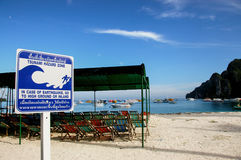 Tsunami warning sign on the beach Stock Photo