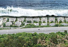 Tsunami. Wave or tsunami about to crash on the houses royalty free stock photos