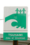Tsunami zone sign. Near the beach in the Pacific ocean in Chile written in Spanish stock photography