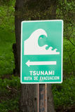 Tsunami zone sign. In a beach at pacific ocean in Chile stock photo