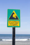Tsunami zone sign. Written in spanish in pacific ocean beach in Chile Royalty Free Stock Photos