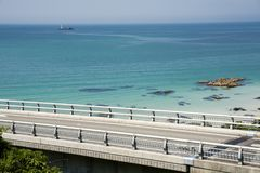 Bridge and blue green sea. Tsunoshima Ohashi bridge in front of blue green sea under sky Stock Photography