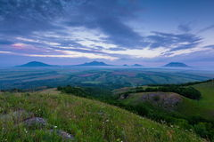 TSunset on Mount Lysogorka with views of Mount Beshtau. Time lapse. Russia, the Caucasus Mountains, Kabardino-Balkaria. Sunset on Mount Lysogorka with views of stock video footage