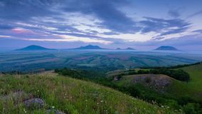 TSunset on Mount Lysogorka with views of Mount Beshtau. Time lapse. Russia, the Caucasus Mountains, Kabardino-Balkaria. Sunset on Mount Lysogorka with views of stock video