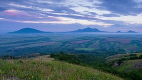 TSunset on Mount Lysogorka with views of Mount Beshtau. Time lapse. Russia, the Caucasus Mountains, Kabardino-Balkaria. Sunset on Mount Lysogorka with views of stock footage