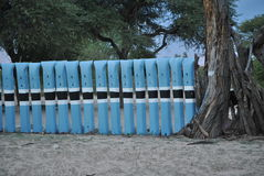 Tswana traditional court fenced with metal rails painted blue white and black. A Tswana traditional court during the independence celebration painted with colors Stock Photo