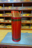 Tsz wan temple, with a hell representation, with sticks inside of a red wooden canister, in Hong Kong, China.  Royalty Free Stock Photos