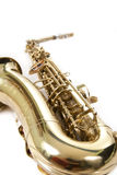 tät guld- saxofon upp Arkivfoto