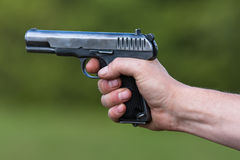 the TT pistol in hand Royalty Free Stock Images