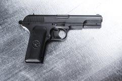 TT pistol. Soviet gun on vintage metal background Stock Images