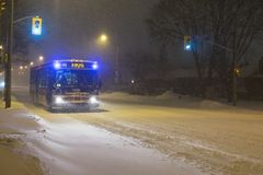 TTC bus driving on Bloor street, Toronto, during snow storm. stock images