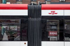 TTC logo on a New Streetcar in Downtown Toronto, Ontario. royalty free stock image