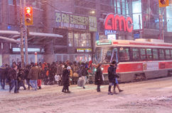 TTC streetcar and passengers during a snowfall in Toronto Royalty Free Stock Image
