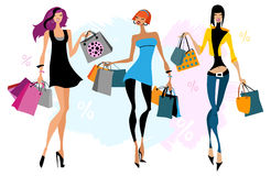 Tthree women with shopping bags Royalty Free Stock Images