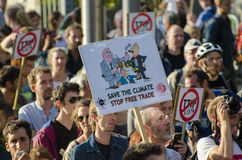 TTIP GAME OVER activist in action during a public demonstration. Activists and signs during the TTIP GAME OVER demonstration in Brussels. A call for direct Royalty Free Stock Photo